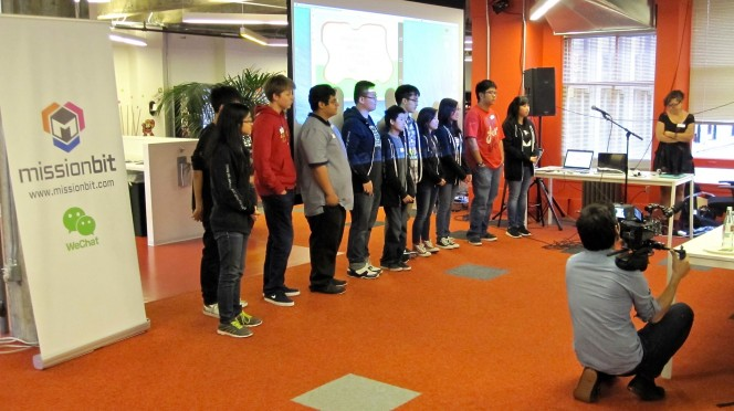 High school students present their final mobile games at Mission Bit's Demo Day.